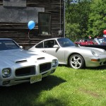 With vintage cars
