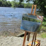 With paintings by the river